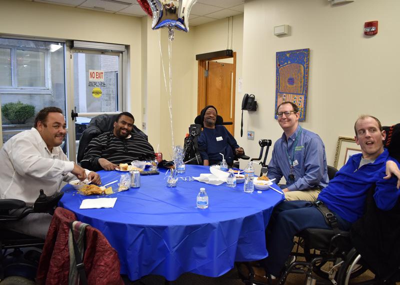 five men having lunch together at a celebration